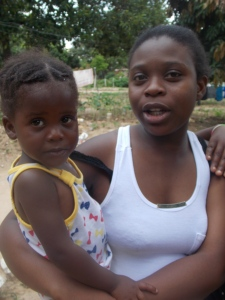 Simon's daughter Ormmie with her daughter Ashley, who is looked after by her grandmother while Ormmie works in South Africa